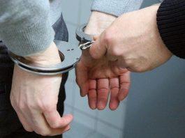verdachte handboeien arrestatie